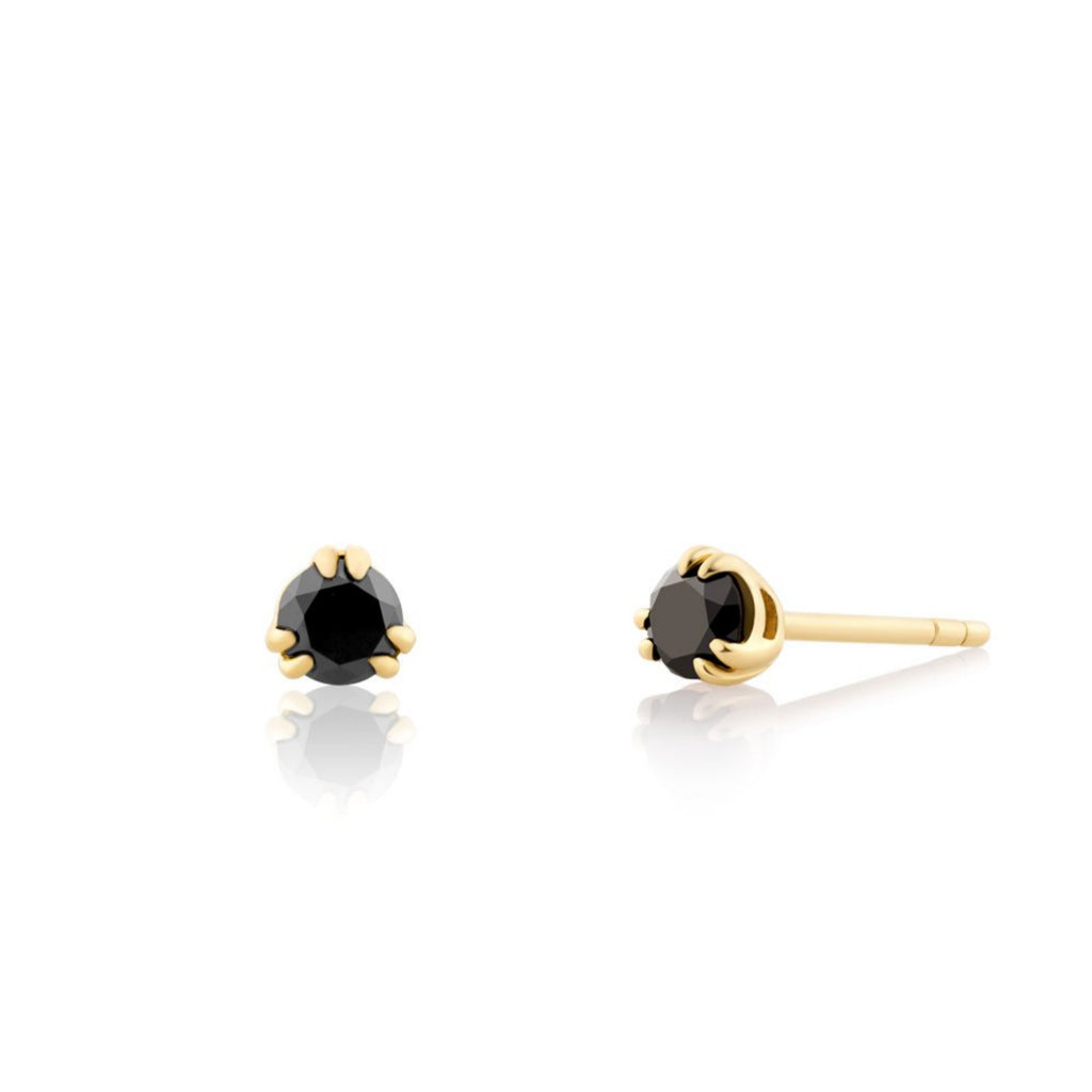 Hand selected natural black round brilliant diamonds in a solid gold