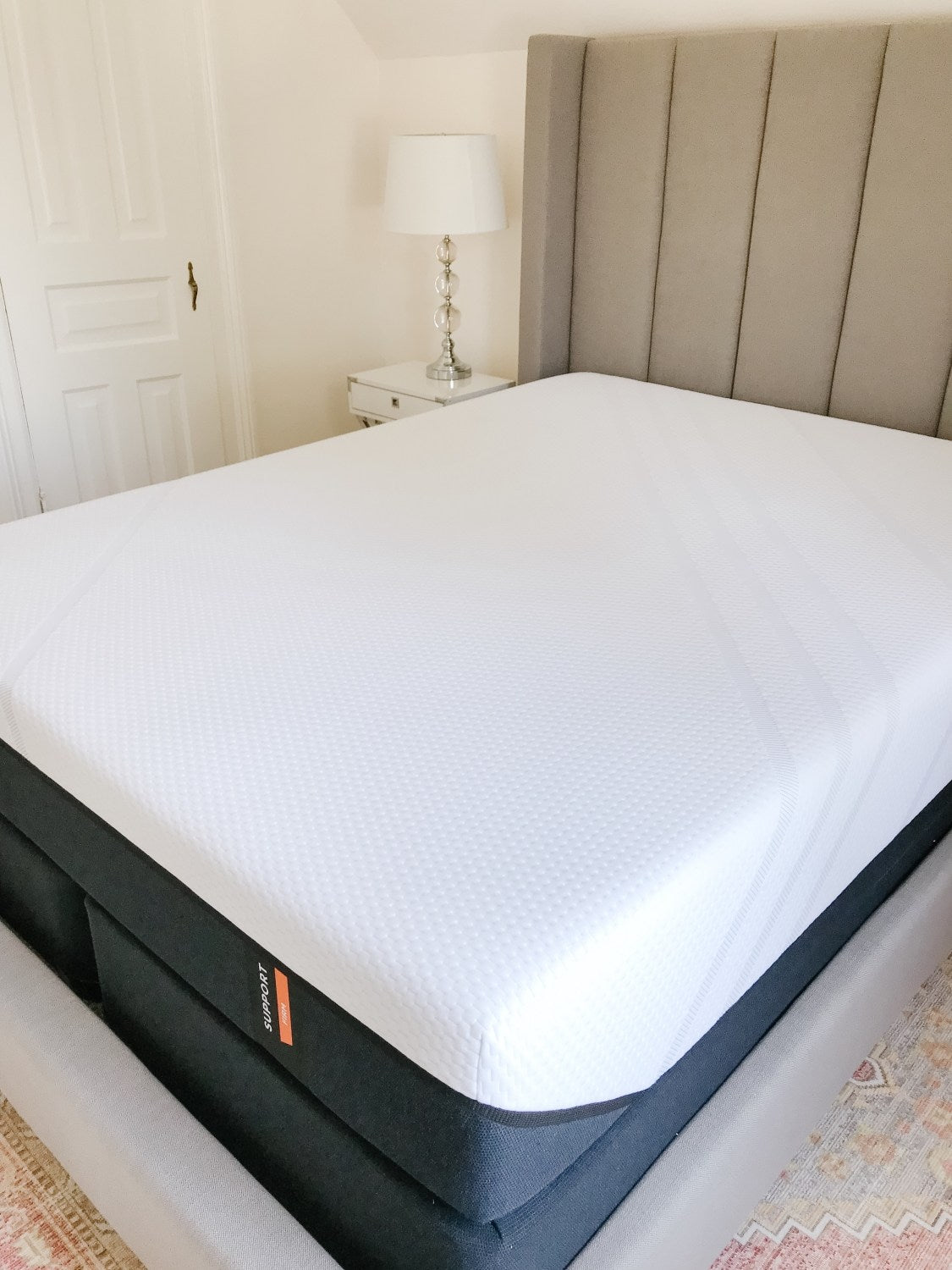 Memory Foam Mattress Laying Bare in A Bed Frame