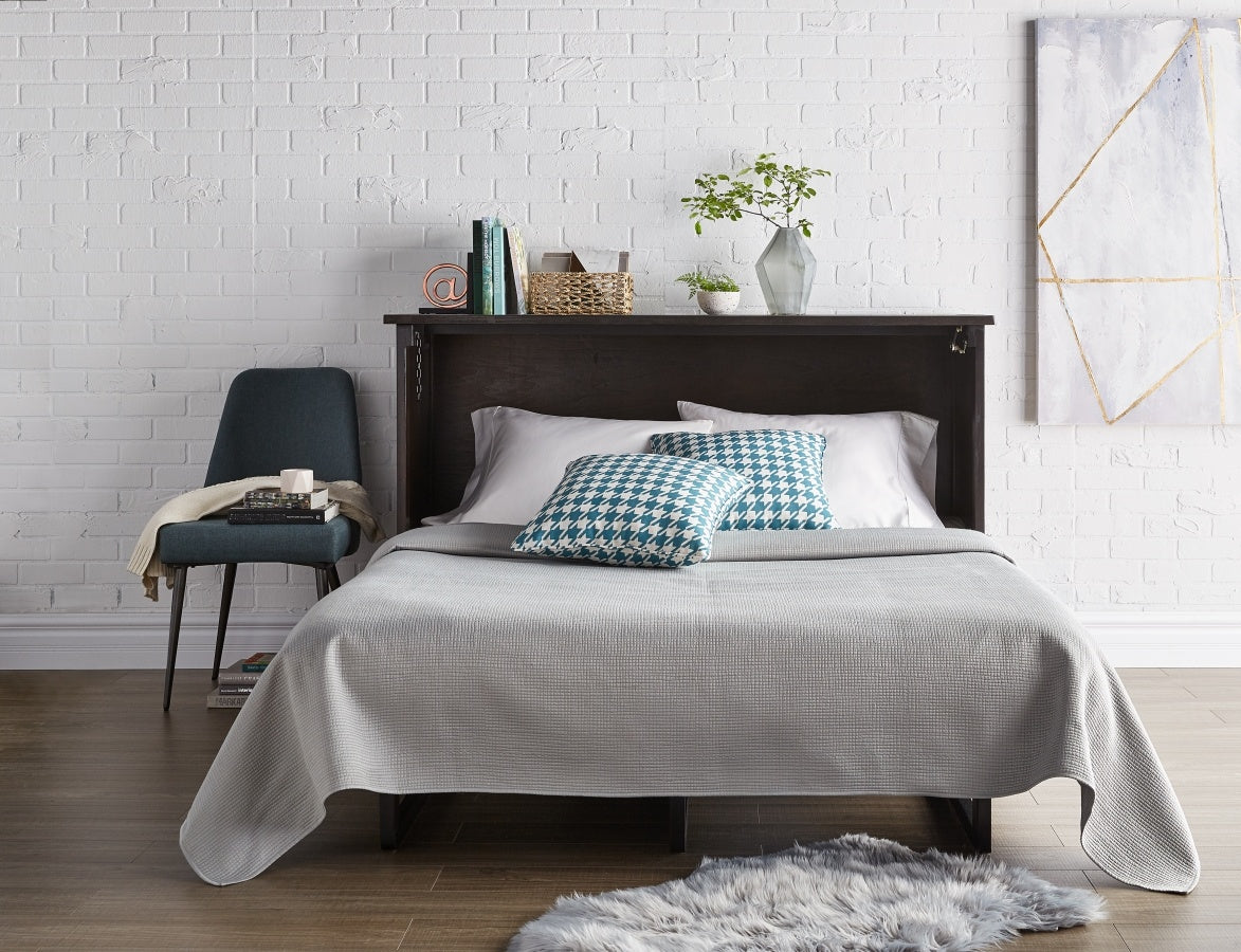 Modern Bedroom With A Dark Wood Bedframe and Grey Top Sheet