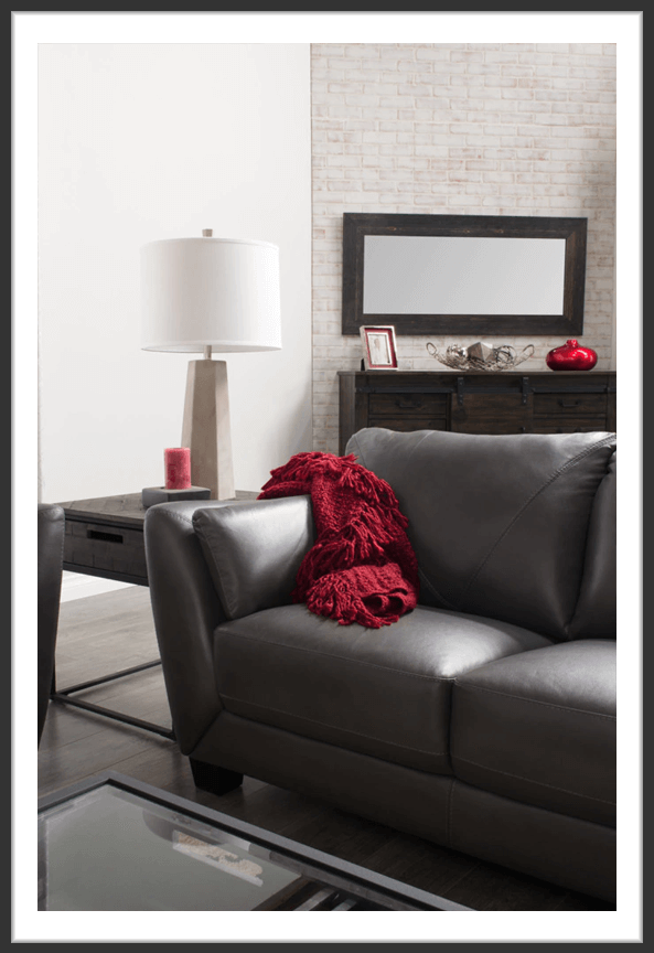 Chateaux d'Ax gray leather loveseat in living room