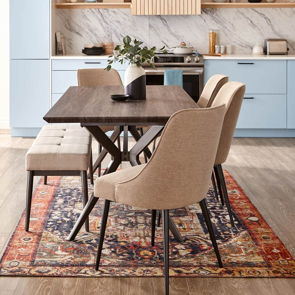 Open concept Scandi kitchen with dining table.