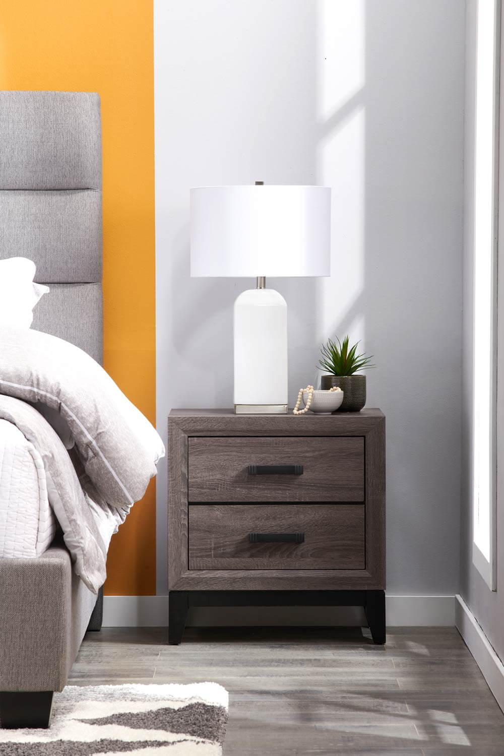 Boutique Bedroom bedside table and lamps.