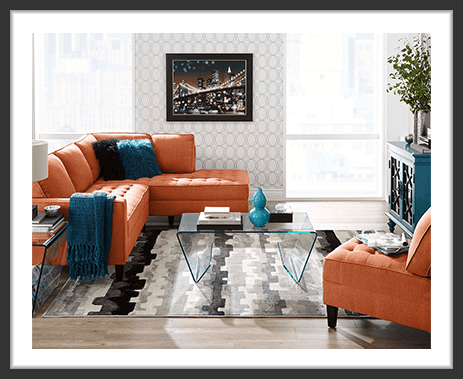 Cindy Crawford Home sectional and chair in living room