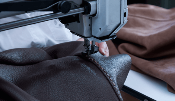 Chateaux d'Ax leather being stitched in the factory