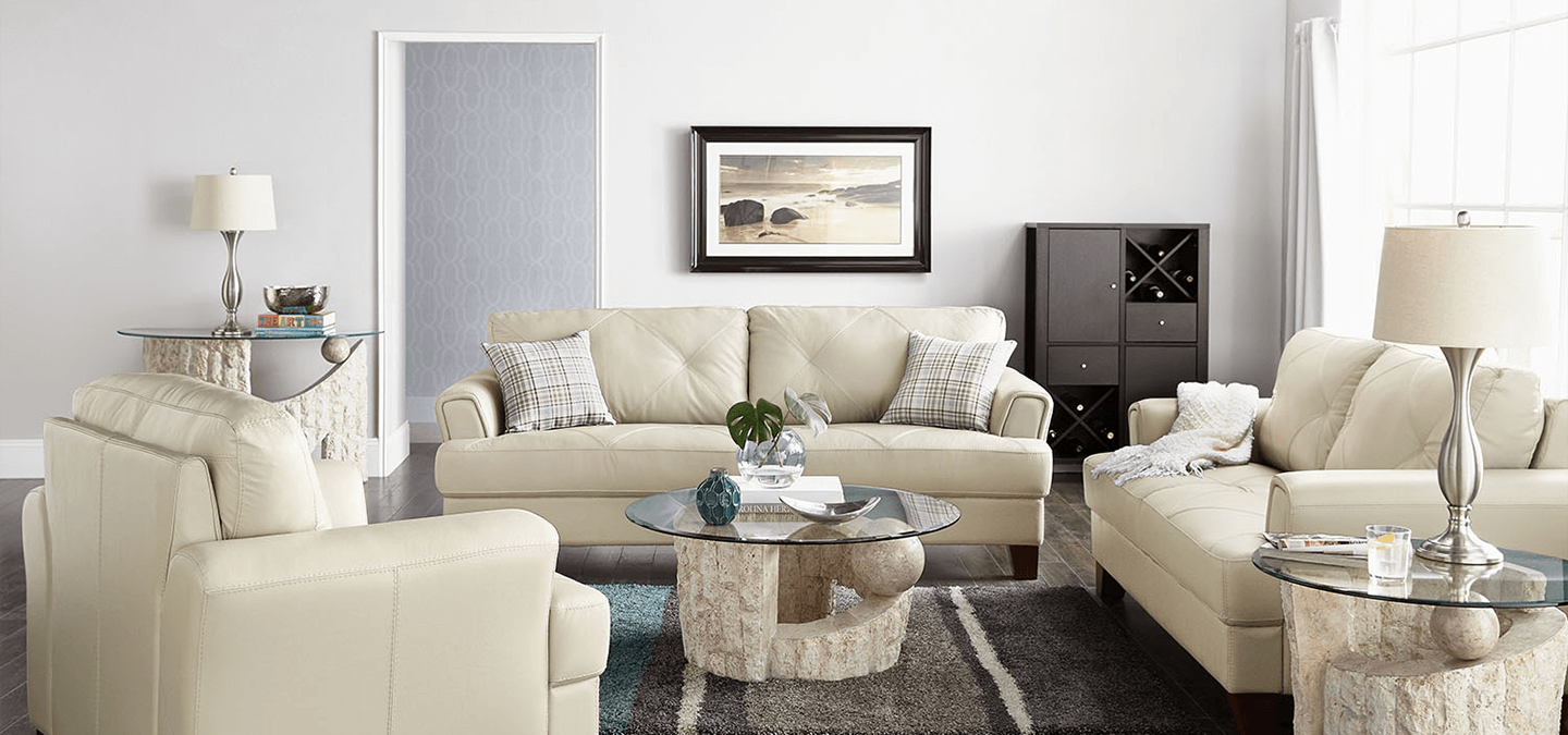 Cindy Crawford leather sofa, loveseat, and chair collection in living room