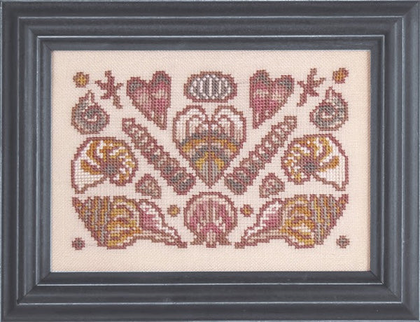 Ink Circles Arranging Seashells Cross Stitch Pattern