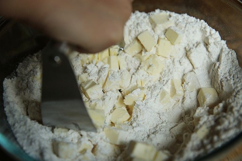 Keep cutting the butter until you reach a consistency of a crumb or pea-like bits mixture