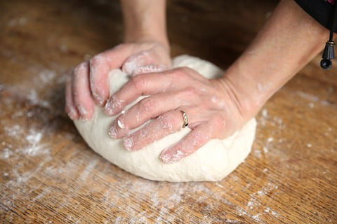 Knead the dough until all dried ingredients are well incorporated resulting into a smooth, soft texture.
