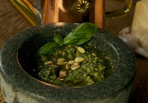 bowl of basil pesto sauce