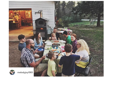 group of families enjoying outdoor meal