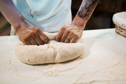 male hands making bread dough