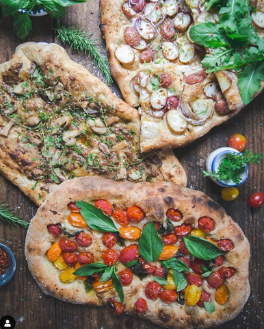 Naan pizza on wooden background