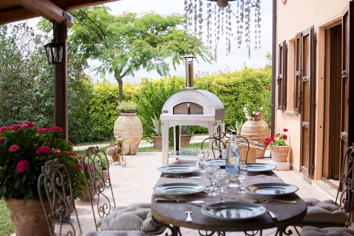 tables and chairs in outdoor with wood fired Ppizza ovens