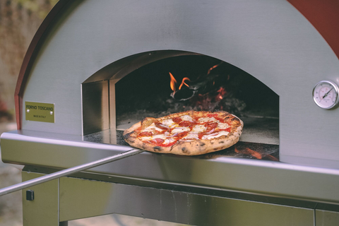 wood burning pizza oven at pizzas being baked