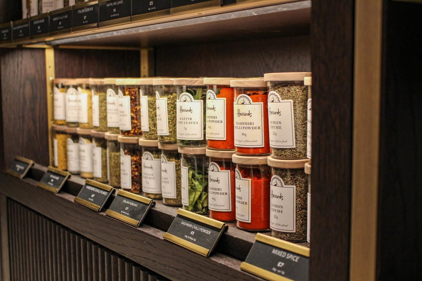 wooden shelf with bottles of spices