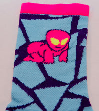 close up of the weird and funky alien baby cycling sock