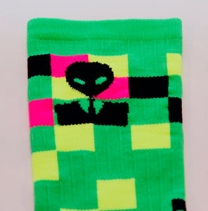 close up of the super bright alien cycling sock