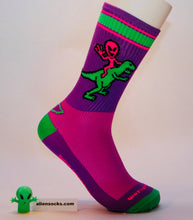 weird, colorful, and bright. Alien riding Dino cycling sock