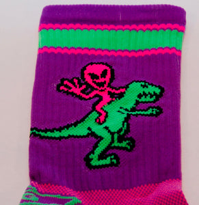 close up of alien riding dino cycling sock