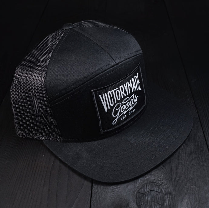 PATCHED 7 PANEL TRUCKER SNAPBACK - BLACK