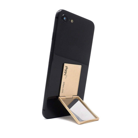 A thin phone stand in gold