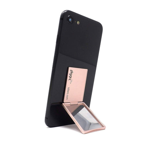 A thin phone stand in rose gold