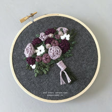 Rich purple and green embroidered bouquet hoop art by And Other Adventures Embroidery Co