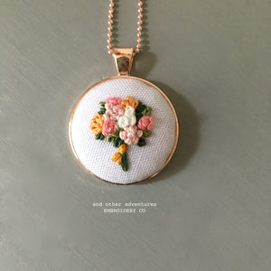 Hand stitched floral bouquet necklace by And Other Adventures Embroidery Co