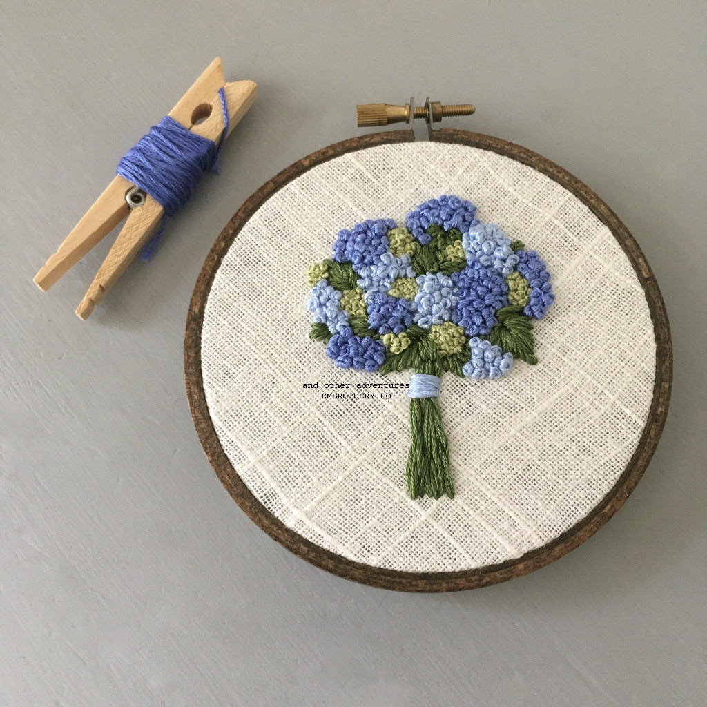 Blue hydrangea bouquet embroidery hoop by And Other Adventures Embroidery Co