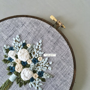 Hand stitched spring flower bouquet hoop art by And Other Adventures Embroidery Co