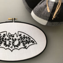 floral bat embroidery