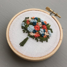 Embroidered blue and orange bouquet