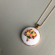 Hand embroidered floral bouquet necklace by And Other Adventures