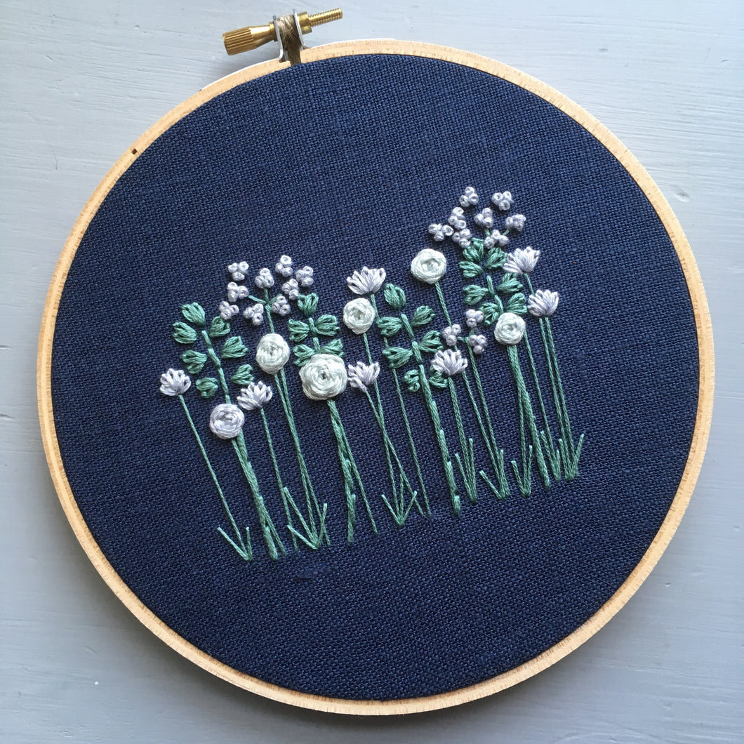 Embroidered flowers on navy