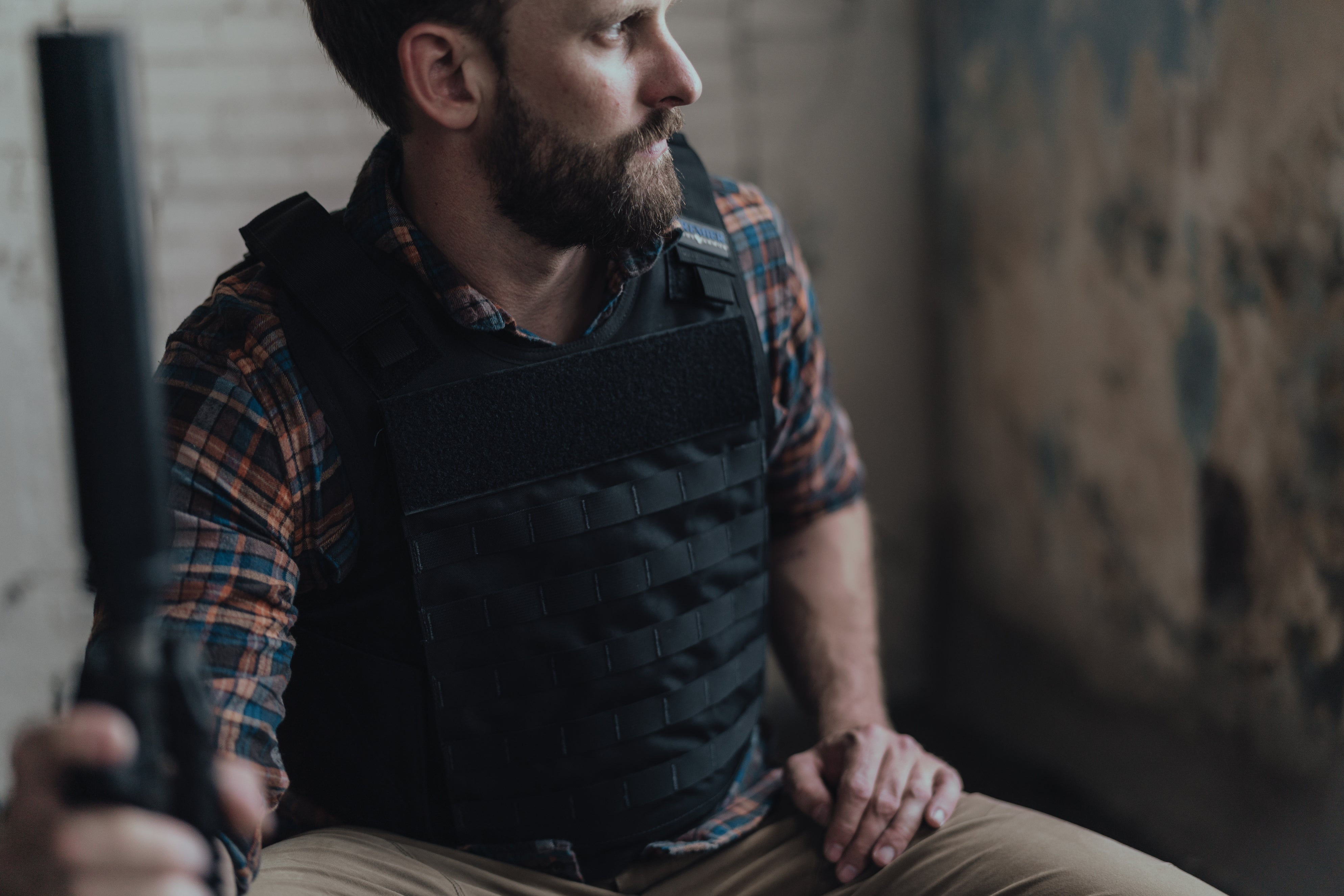 Hybrid Tactical Vest worn by a male model.