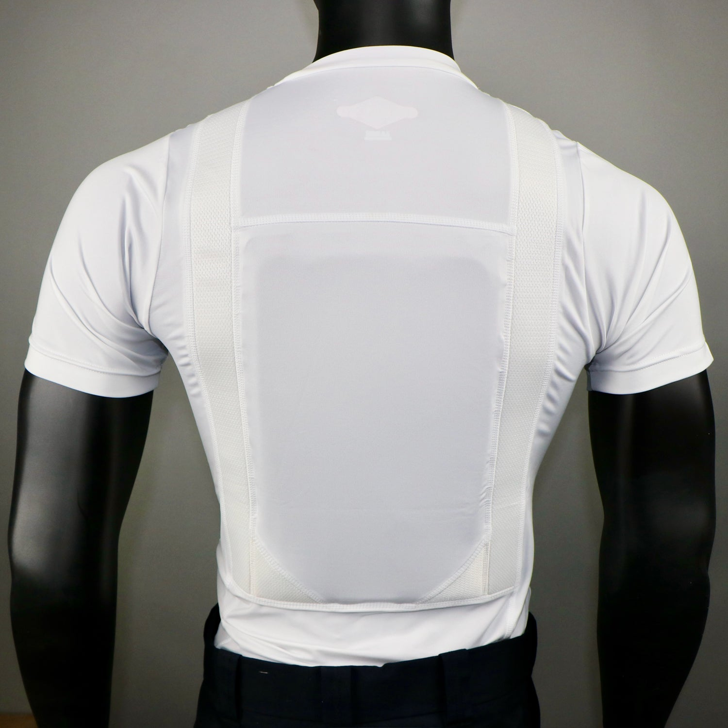 Tru-spec concealed armor shirt in white on a mannequin with a Level IIIA armor insert in the chest panel pocket.