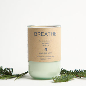 "Glass jar candle that says, ""Breathe"", and supports Mental Health nonprofits."