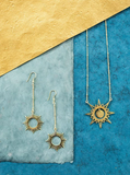 Necklace and earrings with sun shape designs that provide employment opportunities for women artisans in India.
