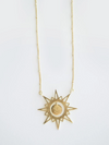 Long necklace with a hanging smiling sun design hanmade by artisans in India.
