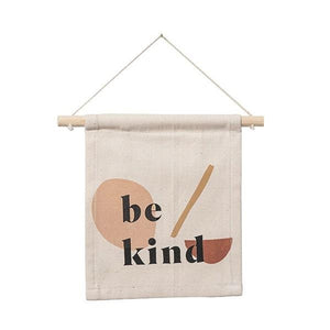 "Handmade cotton banner that says, ""Be Kind""."