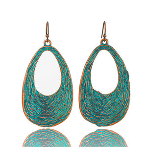 Antique green metal water drop earrings