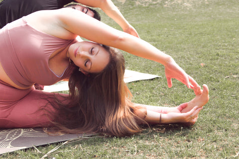Yogis Practicing Outdoor Yoga On An Eco Friendly Yoga Mat