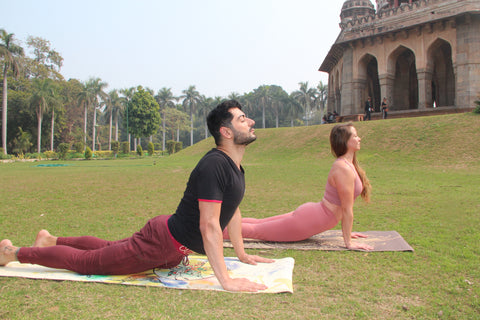 Two Yogis in Cobra Pose In India