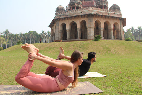 Two Yogis in Bow Pose in India