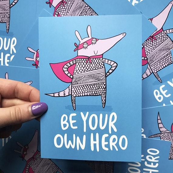 Be Your Own Hero - A6 Postcard by Katie Abey - Postcards - Spiffy
