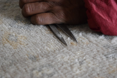 Hand Clipping the rug by The Rug Decor