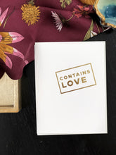 Contains Love Greeting Card
