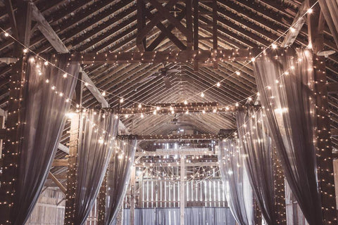interior barn room all decorated with lights