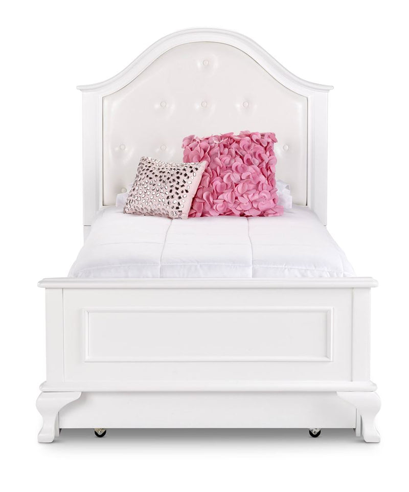 White twin bed with upholstered headboard and trundle