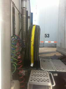 Installed Semi truck spare tire carrier rack for tractor trailers on the back of the cab